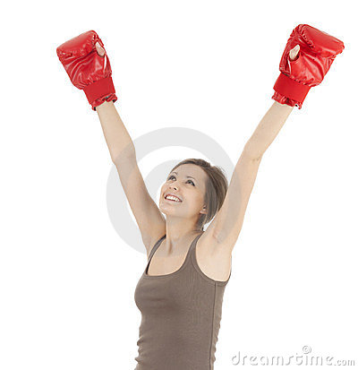 Successful girl wearing boxing gloves