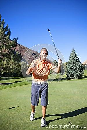 Successful Golfer Making Putt