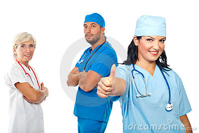 Successful group of doctors give thumbs