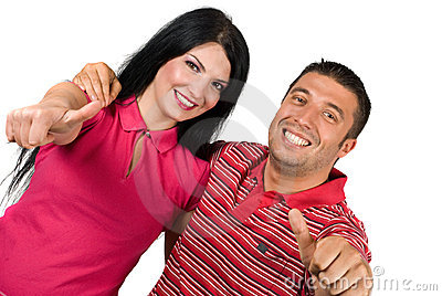 Successful happy couple with thumbs-up
