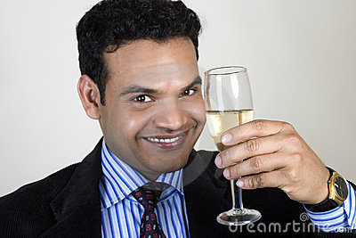 Successful Indian business man toasting