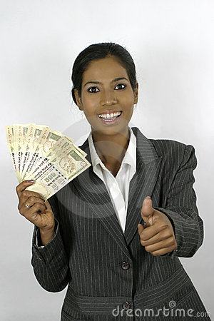 Successful indian business woman holding money