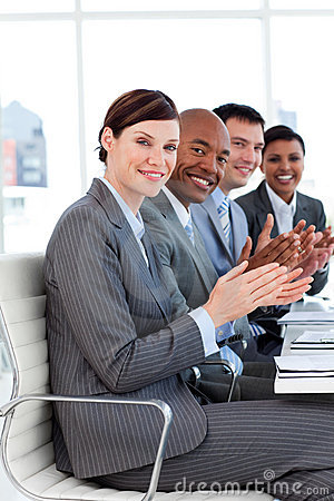 Successful international business people clapping