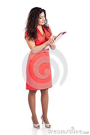 Successful nurse or woman doctor writing