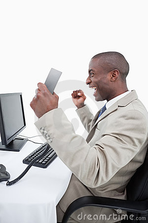 A successful salesman holding a phone handset