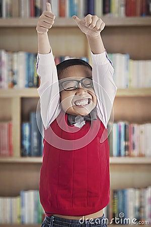 Successful schoolboy in library