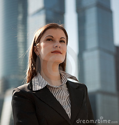 Successful woman against the business center
