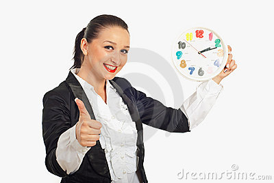 Successful woman holding clock