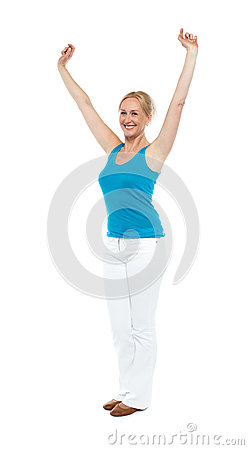 Successful woman posing with raised arms