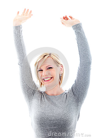 Successful woman raising arms in exultation