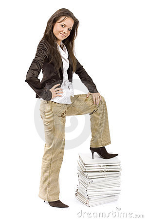 Successful woman standing on the pile of files