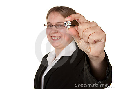 Successful young business woman holding diamond