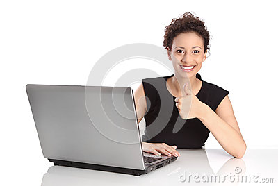 Successful young business woman - isolated with laptop and thumb
