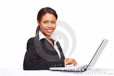 Successful young business woman working on laptop