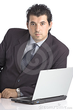 Successful young businessman with a lap top computer
