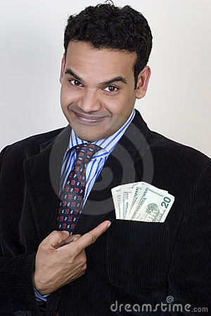 Successful young indian with money in pocket