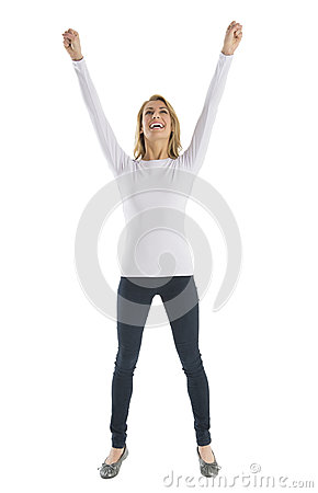 Successful Young Woman With Arms Raised