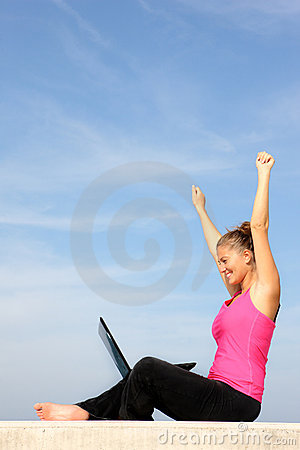 Successful young woman with her laptop