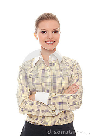 Successful young woman standing folded arms