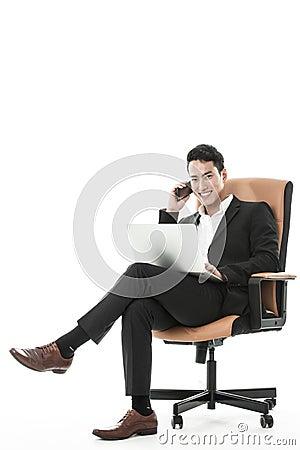 The sucessful businessman multitasking