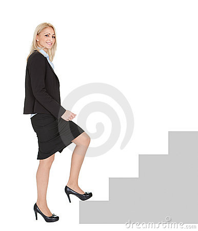 Sucessful businesswoman walking up a staircase