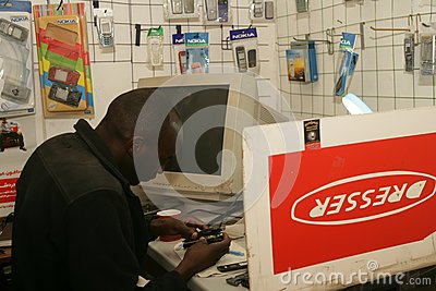 A Sudanese refugee in his mobile phone shop Editorial Stock Image