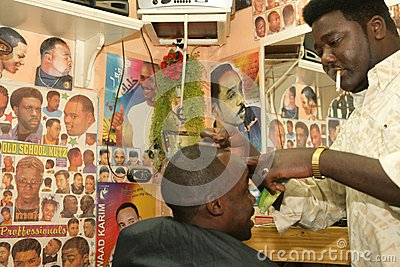 A Sudanese refugee working in a barber shop Editorial Photography