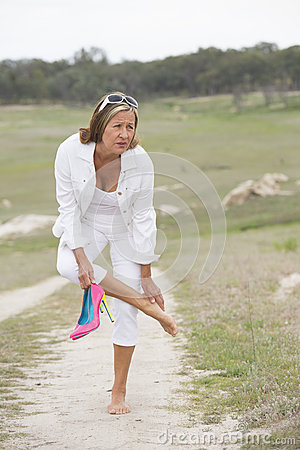 Free Suffering Woman In High Heels With Sore Feet Stock Photos - 46029753