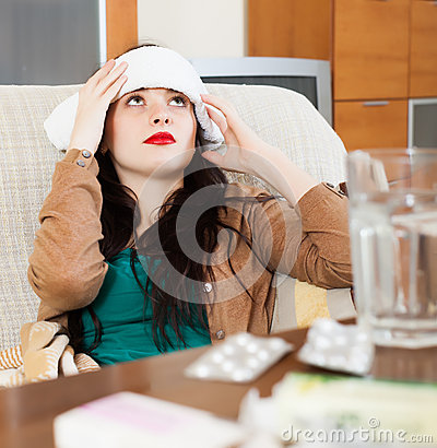 Suffering woman  stuping  towel to  head