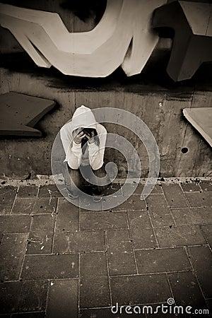 Suffering woman on wall