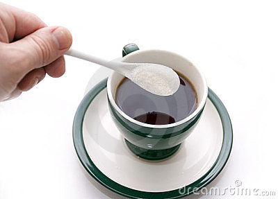 Sugar additive in a cup with tea