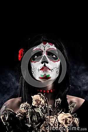 Sugar skull girl with dead roses