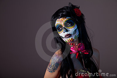 Sugar skull girl with red rose