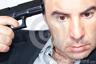 Suicide concept -  man pointing a gun at his head