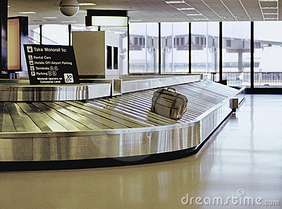 Suitcase on airport carousel