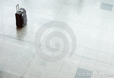 Suitcase with luggage on a floor at the airport