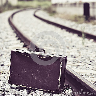 Free Suitcase Next To The Railroad Tracks Stock Image - 88427621