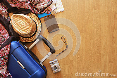 Suitcase and tourist stuff