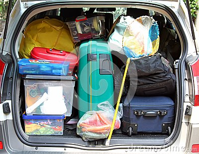 Suitcase in the trunk of the car for family vacations
