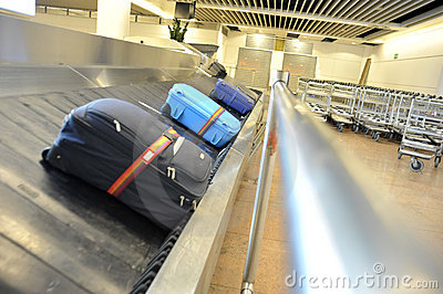 Suitcases on a transportation belt at the airport