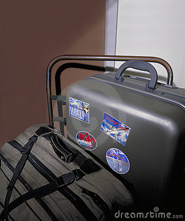 Suitcases with travel stickers on handc