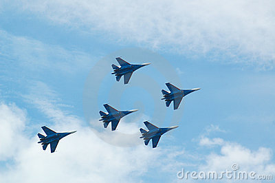 Sukhoi Su-37 jet fighter aircrafts in the blue sky