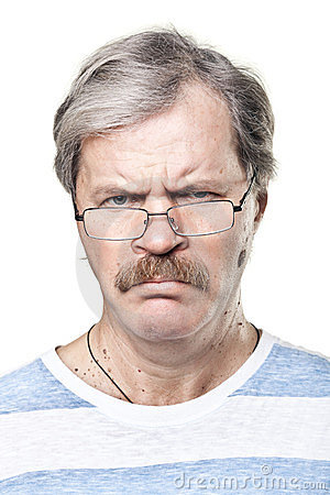 Sullen caucasian mature man in glasses isolated