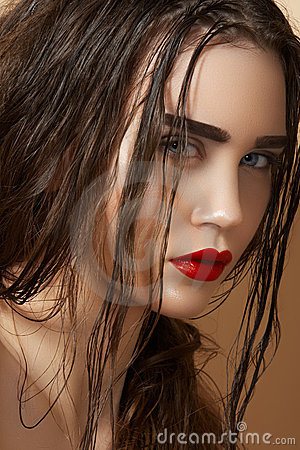 Sultry look of model with damp wet hair & make-up