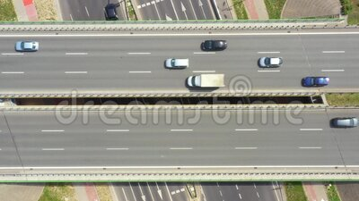 Summer aerial footage of transport junction, traffic cross road junction day view from above with highway road. Top down view of. Traffic jam stock video