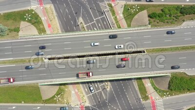 Summer aerial footage of transport junction, traffic cross road junction day view from above with highway road. Top down view of. Traffic jam stock footage