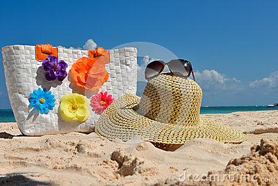 Summer beach bag with straw hat and sunglasses