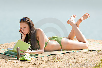 Summer beach woman relax with book bikini