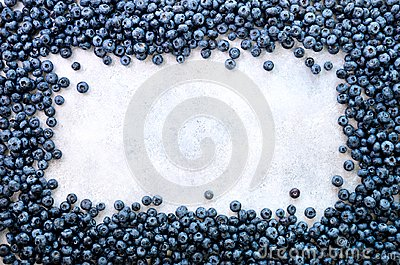 Summer berries background. Top view. Food frame with assorted mix of strawberry, blueberry. Vitamin, vegan, vegetarian Stock Photo
