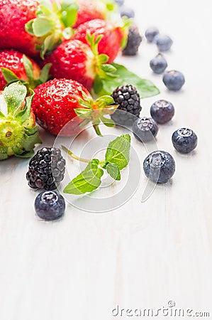 Free Summer Berries: Blackberries, Blueberries, Strawberries On White Wooden Background Stock Image - 51704331